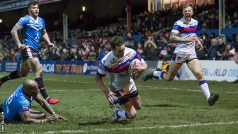 Scott Grix slides down for the first Wakefield try against Salford
