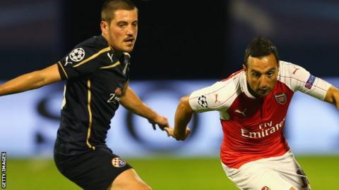 Arijan Ademi takes on Santi Carzola