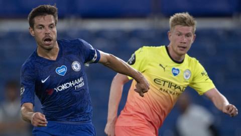Chelsea defender Cesar Azpilicueta (left) and Manchester City midfielder Kevin de Bruyne (right) challenge for the ball during a Premier League match