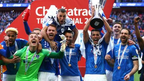Portsmouth players celebrate with the Checkatrade Trophy