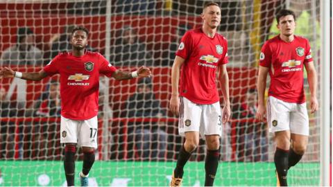 Manchester United's players react during a home defeat to Burnley