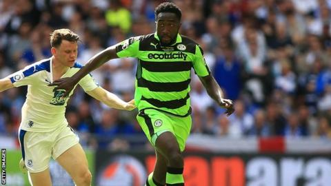 Manny Monthe holds off a challenge from Tranmere forward Connor Jennings