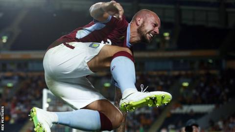 Alan Hutton celebrates his goal for Aston Villa