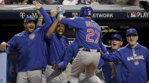 Addison Russell celebrates with the Cubs backroom staff