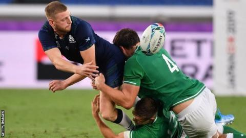 Finn Russell attempts an offload during Scotland's 27-3 defeat to Ireland in Yokohama