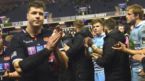 Grant Gilchrist applauds Edinburgh fans as Glasgow's Huw Jones and Jonny Gray look dejected