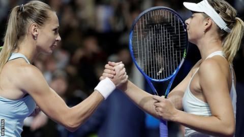 Maria Sharapova and Magdalena Rybarikova shake hands after their match att he Kremlin Cup