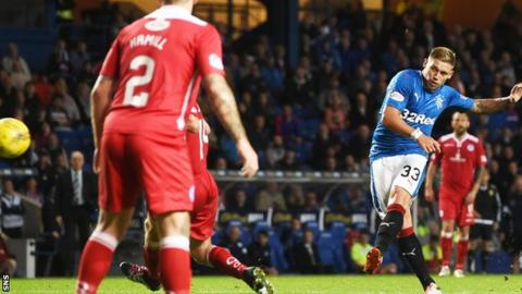 Martyn Waghorn steers home the first goal of his hat-trick