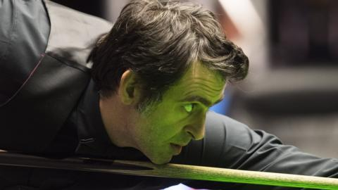 Ronnie O'Sullivan plays a shot against Robert Milkin