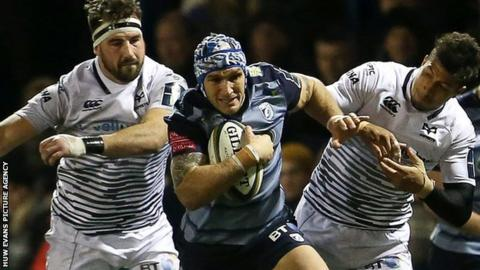 Tom James makes a break for Cardiff Blues against Ospreys