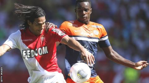 Radamel Falcao of Monaco (left) and Montpellier's Teddy Mezague in action in 2013