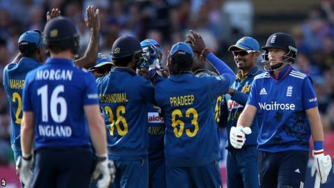 Joe Root (right) walks off after being dismissed by Angelo Mathews