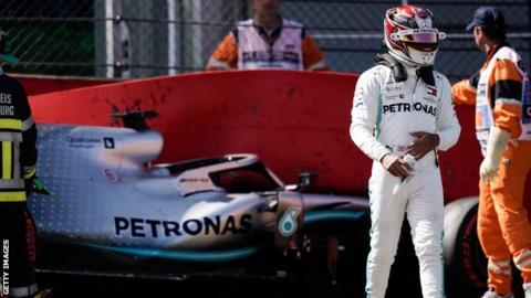 Lewis Hamilton walks away from his car