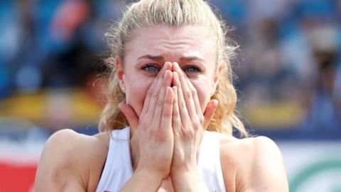 Beth Dobbin covers her mouth in shock after winning the British 200m title