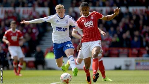Ipswich Town winger Danny Rowe battles for the ball with Nottingham Forest's Michael Mancienne