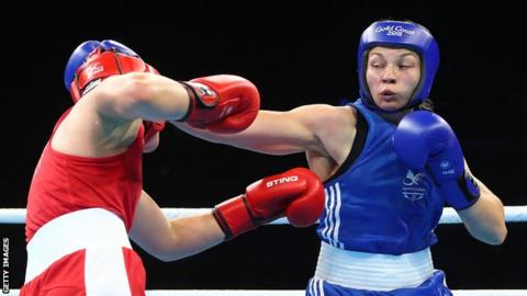 Boxer Lauren Price (right) aims a right hook at her opponent during a fight