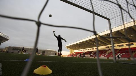 Edinburgh City goalkeeper Andrew Stobie goes through his pre-match warm up routine.