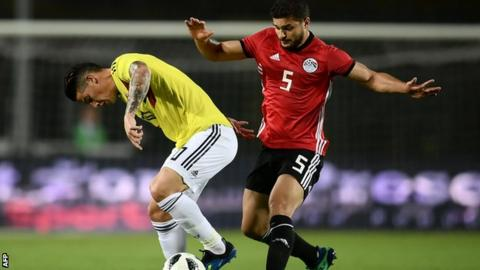 Colombia forward James Rodriguez vies for the ball with Egypt's Sam Morsy