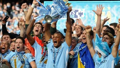 Manchester city captain Vincent Kompany and his team mates celebrate their Premier League success in 2012