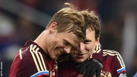 Pavel Mamaev and Alexander Kokorin embrace