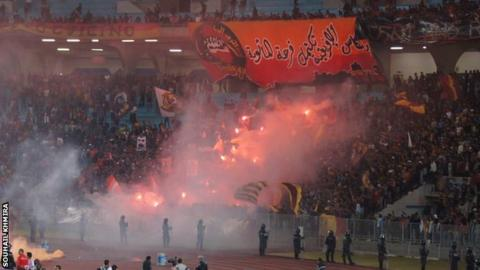 Esperance fans with flares