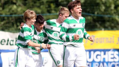 Celtic's Connor Farrelly celebrates scoring in an Under-14 match against Bertie Peacock Youths