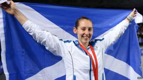 Kirsty Gilmour holds up a Scotland flag