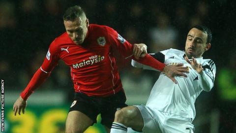 Cardiff City's Craig Bellamy in action against Leon Britton of Swansea City
