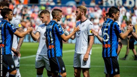 Oliver McBurnie of Swansea City shakes hands after the game against Atalanta
