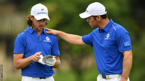 Tommy Fleetwood and Paul Casey talk during day one's fourballs at the EurAsia Cup in Malaysia