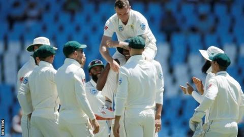 Dale Steyn lifted up by his South Africa team-mates