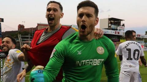 Joe Day celebrates after helping Newport reach Wembley