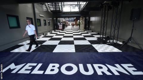 A man walking down a corridor at Albert Park in Melbourne