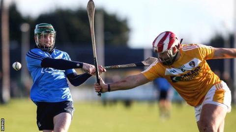 Dublin's Ben Quinn sees his shot blocked by Saffrons opponent Kevin McKernan