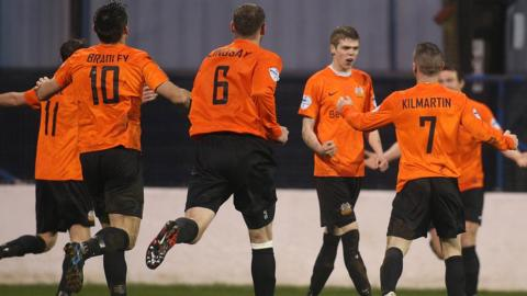 Glenavon players rush in to congratulate Rhys Marshall after he scores the opener in a 2-0 win over the Bannsiders