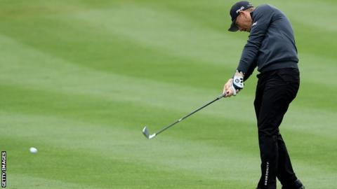 Matt Wallace plays his second shot on the second hole during the final round of the Players Championship in Sawgrass