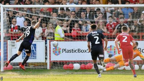 James Collins scores a penalty for Luton to put them 1-0 up at Accrington
