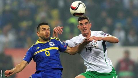 Republic of Ireland defender Ciaran Clarke is about to challenge Bosnia & Herzegovina's Vedad Ibisevic