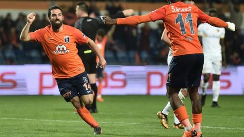 Turan banned 16 games for pushing official