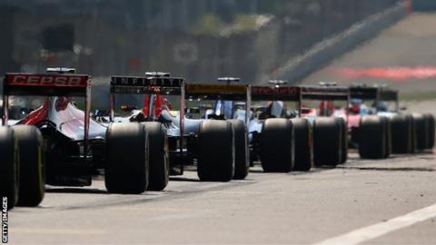 Formula 1 cars line up on the grid