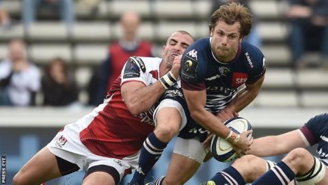 Ruan Pienaar grimaces as he tackles Bordeaux's Yann Lesgourgues in Sunday's game