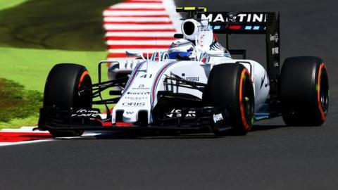 Susie Wolff drives during practice at this year's British Grand Prix