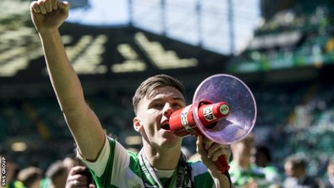 Kieran Tierney leads the singing at Celtic Park as the Premiership trophy was presented on Sunday
