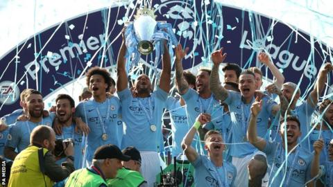 Manchester City's players celebrate winning the Premier League