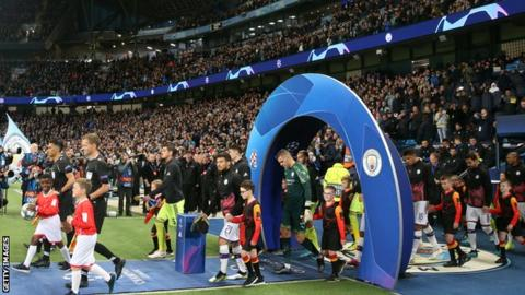 Manchester City walk out to play at the Etihad