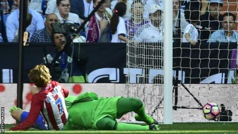 Antoine Griezmann scores for Atletico Madrid against Real Madrid