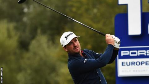 Graeme McDowell tees off at the 12th hole in Germany