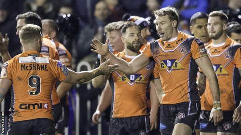 Castleford players celebrate a try