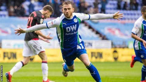 Wigan striker Joe Garner celebrates