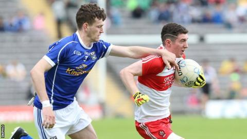 Tiarnan Flanagan battles with Cavan's Donal Monahan in the Ulster Minor Final